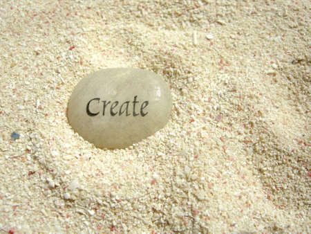 mentality: a create stone in the sand on a beach