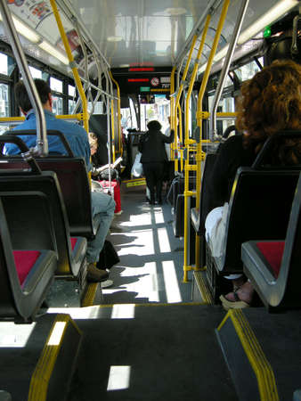 public transportation: passengers getting off and on a city transit transportation bus