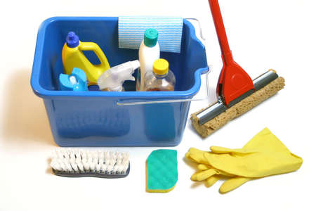 housecleaning: cleaning products inside bucket with gloves, mop, cloth and  sponge Stock Photo