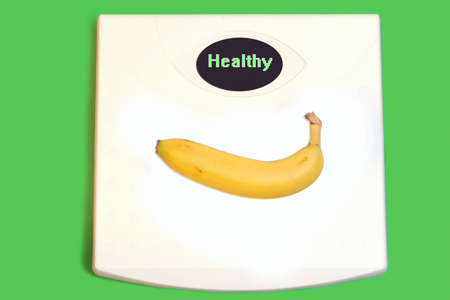 stating: conceptual image of healthy food like fruit on scale with healthy stating a good choice in diet