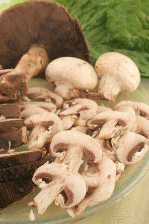 gills: big freshly picked portabello mushrooms and smaller sliced button mushrooms ready for cooking Stock Photo