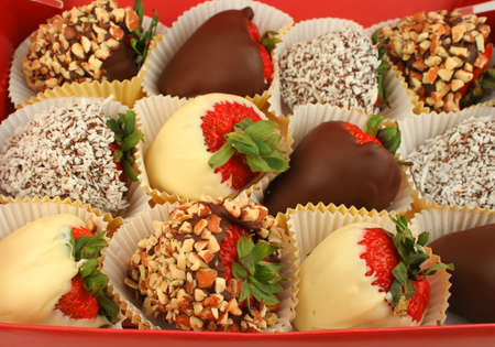 chocolate treats: box of large strawberries dipped in chocolate, coconut and nuts