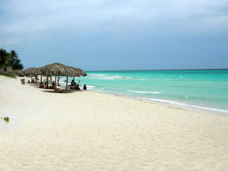 locals: Cubans relaxing in the warm weather at Varadero beach, Cuba