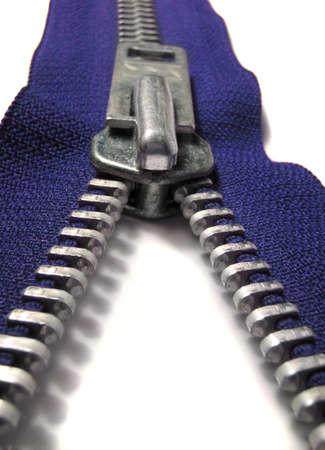 macro image of blue zipper being unzipped or zipped up