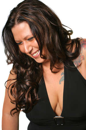 tattoed: tattooed brunette woman  smiling with eyes closed on a white background Stock Photo