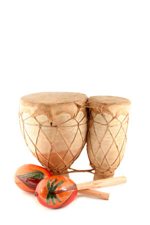 bongos: decorative musical  hand shakers known as maracas and african drum on white background Stock Photo