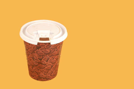a cup of coffee to go on a yellow background