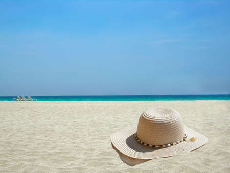 headwear: straw hat on the shore of a Caribbean beach                          Stock Photo