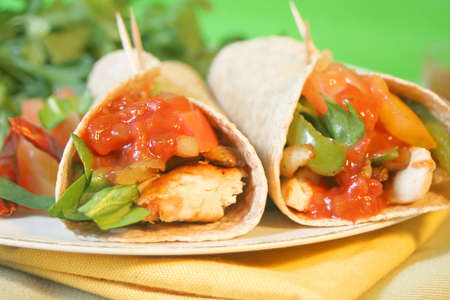 delicious and colorful  mexican style  whole wheat chicken fajitas with vegetables, and salsa