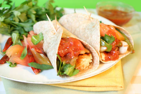 delicious and colorful  mexican style  whole wheat chicken fajitas with vegetables, and salsa  photo
