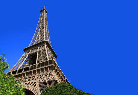 sightsee: Eiffel  Tower, Paris, France under a sunny, clear, bright blue sky