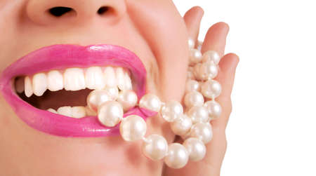 glamorous pink  lips biting down on  pearls Stock Photo