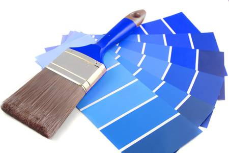 saturation: blue shade paint swatches, and small roller brush for home decorating