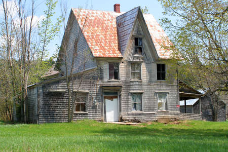 haunted house: spooky, broken down, abandoned house in  a rural property
