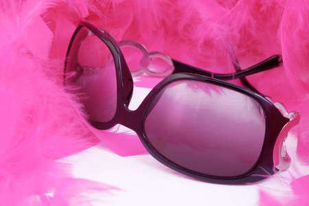 glamorous pink feather boa and stylish sunglasses Stock Photo
