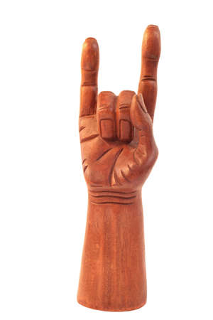 wood carved hand in the position to ward off the evil eye used in folklore or  used as a symbol known as devil horns by metal music fans