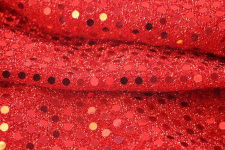 material: close-up of glamorous and sexy red sequin material  Stock Photo