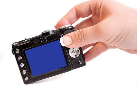 Donna la mano vale un punto e sparare fotocamera digitale compatta  Archivio Fotografico - 3265724