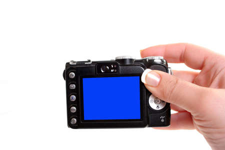 womans hand holds a point and shoot compact digital camera Imagens