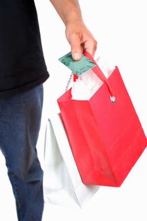 man holding a plastic credit or debit card with shopping gift bags