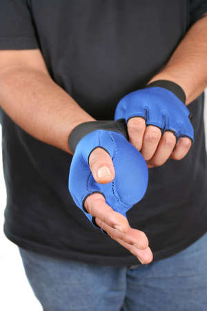 weighted: man puts on weighted gloves for workout