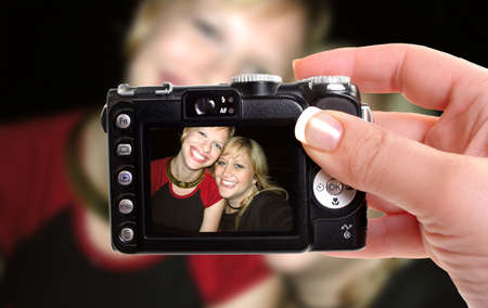 best: woman takes snapshop of best friends smiling