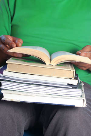 African American college male student with books on his lap reading Stock Photo - 3376015