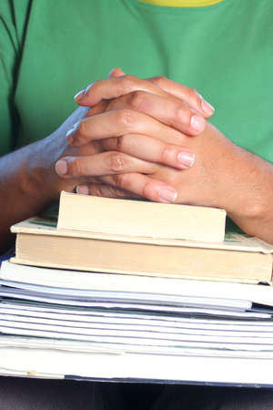 African American college male student with books on his lap  and hands folded Stock Photo - 3376013