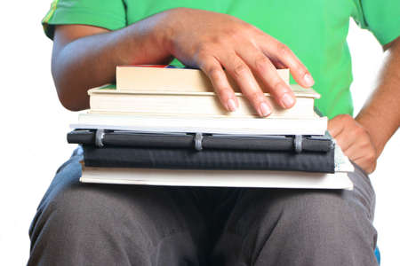 African American college male student with books on his lap and hands on them Stock Photo - 3376017