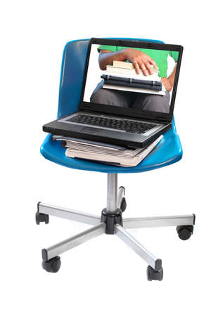 schooling: textbooks, notebooks  and computer laptop on blue swivel chair with image of seated student  holding books showing online schooling Stock Photo