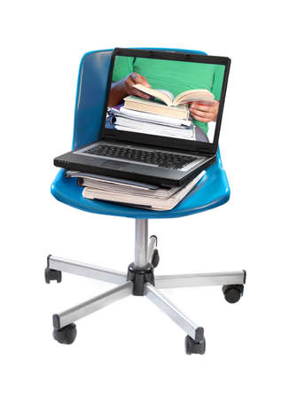 schooling: textbooks, notebooks  and computer laptop on blue swivel chair with image of seated student  holding books showing online schooling