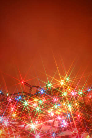 colorful twinkling christmas lights background with copyspace Фото со стока