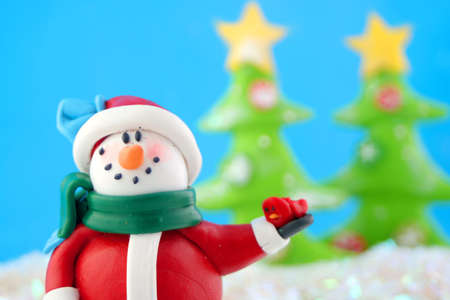 fantasy wonderland scene with  snowman  and christmas trees in the background photo