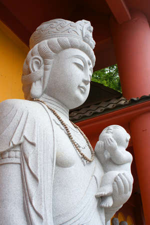 buddhist temple statue of a woman holding a