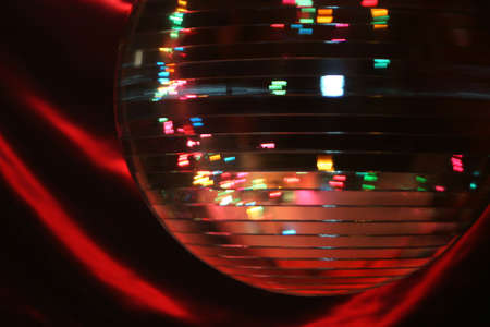 vibe: spinning mirror disco ball giving off a party vibe at a discoteque