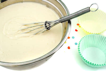 cake flour mix batter and whisk  in the middle getting ready for a party