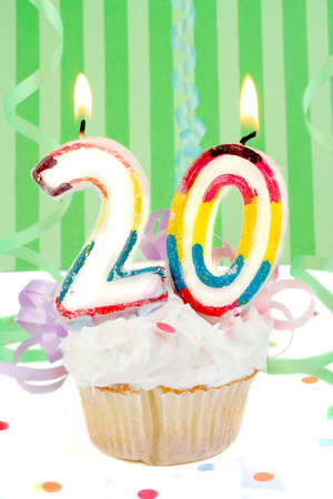 twentyeth birthday cupcake with white frosting and green decorative background  Stock Photo - 3469650