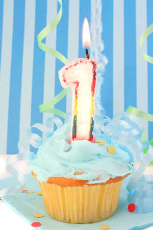 baby boy's first birthday cupcake with blue frosting and  decorative background Stock Photo - 3479694
