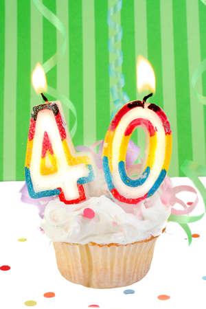 fortieth birthday cupcake with white frosting and green decorative background  Stock Photo