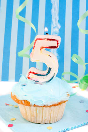 fifth:  boys fifth birthday cupcake with blue frosting and  decorative background