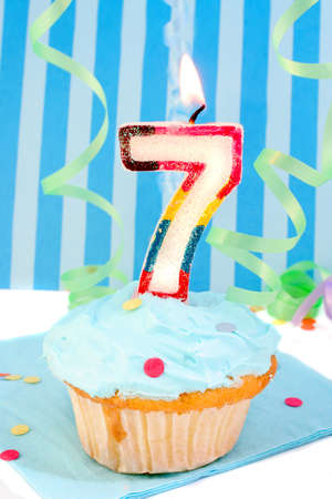 boys seventh birthday cupcake with blue frosting and  decorative background  Stock Photo