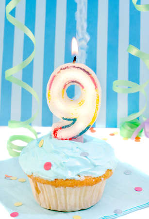 ninth:  boys ninth birthday cupcake with blue frosting and  decorative background