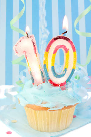 boys tenth birthday cupcake with blue frosting and  decorative background  Stock Photo
