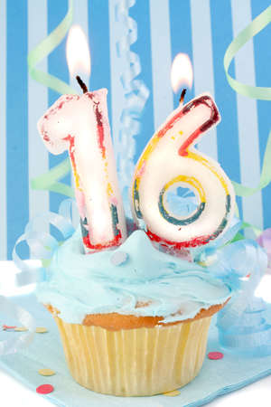 sweet sixteen: teenagers sixteenth  birthday cupcake with blue frosting and  decorative background