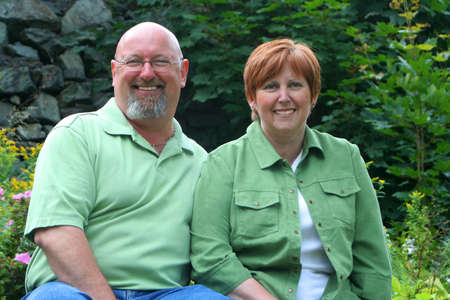 an attractive smiling middle aged couple outdoors portrait