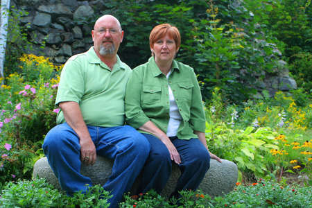 aged: an attractive middle aged couple outdoors portrait