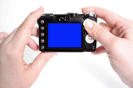 womans hands hold camera with blank screen, taking snapshot pictures Imagens