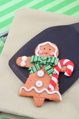 christmas gingerbread cookie on a spatula fresh out of the oven photo