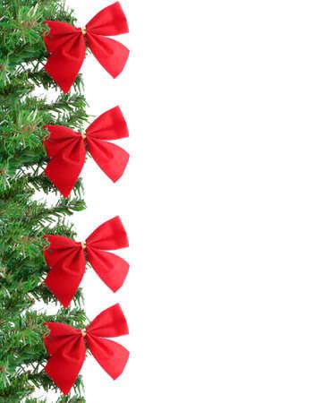 fake christmas tree: fake pine tree christmas border with red festive bows Stock Photo