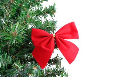 fake christmas tree: fake pine tree christmas border with red festive bow
